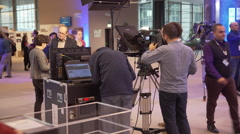 People working in a TV set at the European Parliament Stock Footage