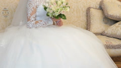 Bride sitting on sofa during photo session indoors Stock Footage