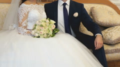 Bride and groom during wedding photo set indoors Stock Footage
