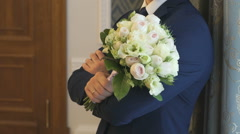 Groom during wedding photo session indoors Stock Footage
