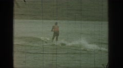 1961: one man skating in the water and another one lying in the water MICHIGAN Stock Footage