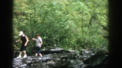 1958: three individuals hiking on rocks DAYTON OHIO Stock Footage