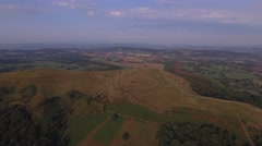 Long aerial view of British Camp in the Malvern Hills. Stock Footage