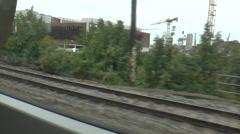 View of Industrial Region in Copenhagen Looking Out from a Train Window Stock Footage