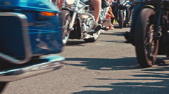 A group of motorcycles pass through the picture low angle shot on the highway Stock Footage