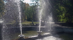 View on the fountain with silhouette of people at the background Stock Footage