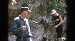 1958: hikers on a woodland trail being cautioned about poison ivy. DAYTON OHIO Stock Footage