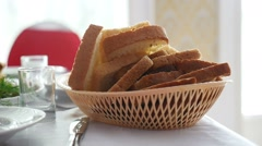 Sliced bread in cup placed on table in restaurant video Stock Footage