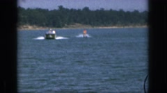 1961: oh the day for water skiing on the lake. MICHIGAN Stock Footage