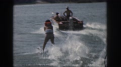 1961: a woman water skiing on waves and holding onto a rope MICHIGAN Stock Footage
