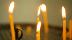 Candles flaming in candlestick Stock Footage