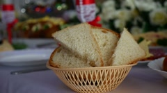 Sliced bread in a cup placed on table in a restaurant video Stock Footage