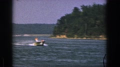 1961: a man is skating in the water pulled by a speed boat MICHIGAN Stock Footage