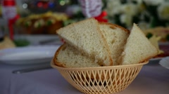 Sliced bread in a cup placed on a table in a restaurant Video Stock Footage
