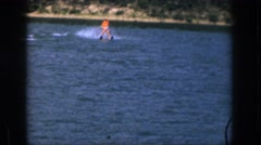 1961: water skiing lake sinking falling life jacket unstable MICHIGAN Stock Footage