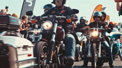 Bikers cruising down the road at a motorcycle parade Stock Footage