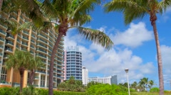 Buildings and palms in Miami Beach Stock Footage