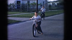 1958: boys ride bicycles down an empty residential street NEW ORLEANS LOUISIANA Stock Footage