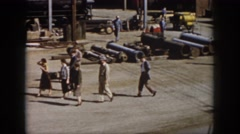 1958: pipes lying around people working walking around observing VIRGINIA Stock Footage