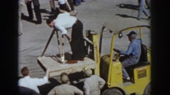 1958: man stands with motion camera on the special vehicle to shoot the event  Stock Footage