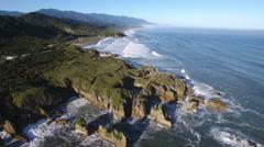 Scenic aerial Pancake Rocks (Dolomite Point), Punakaiki, New Zealand Stock Footage