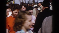 1958: a large crowd of various people walking about each other VIRGINIA Stock Footage
