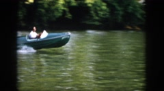 1958: man making circles in blue speedboat on lake VIRGINIA Stock Footage
