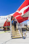 Passengers boarding the Qantas aircraft at Melbourne Airport Stock Photos