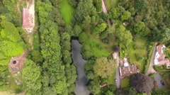Aerial view of a quiet english village around a pool. Stock Footage