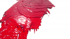 Red paint pouring on white in slow motion. juice. Stock Footage