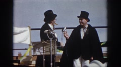 1958: two men in costumes on stage performing a musical act VIRGINIA Stock Footage
