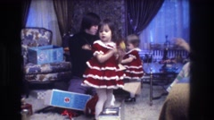 1973: be it the holidays or a birthday, gift-wrapping and being dressed up  Stock Footage