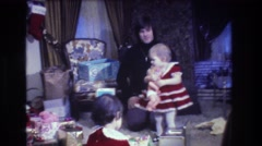 1973: small baby girl with little doll and her mother MEDFORD NEW JERSEY Stock Footage