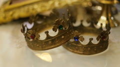 Close up of two wedding crowns prepared for ceremony of marriage in a church Stock Footage