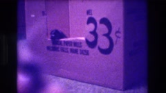 "1973: tiny kitten tentatively crawls out of cardboard box marked with ""33 cents"" Stock Footage"
