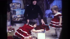1973: cute twins in a beautiful dresses indoor with mother MEDFORD NEW JERSEY Stock Footage