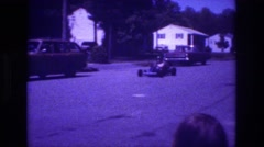 1981: kid driving a go cart moving very fast SAN DIEGO Stock Footage