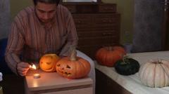 Man set fire pumpkin for Helloween Stock Footage