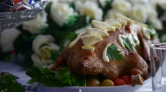 Baked chicken with lemon delicious dinner in restaurant video art Stock Footage