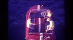 1982: three people riding in a small red boat ACAPULCO MEXICO Stock Footage