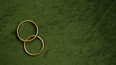 Wedding rings rotating with textured background Stock Footage