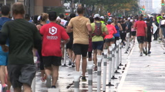 Runners running in the heavy rain downtown in Toronto Stock Footage