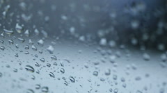 Rain Rain, Go Away. Large rain drops strike a window pane during a summer shower Stock Footage