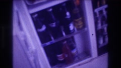 1982: filled bottles are kept inside a white colored refrigerator ACAPULCO Stock Footage