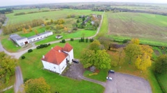 Old castle with red roof. Autumn nature landscape. Camera around.Aerial footage. Stock Footage