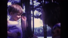 1975: woman playing with child BAXTER MAINE Stock Footage