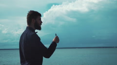 Young stylish man smoking electronic cigarette Stock Footage