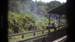 1975: man sitting on miniature train moving fast BAXTER MAINE Stock Footage