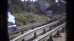 1975: people driving on a small trains towards each other. BAXTER MAINE Stock Footage