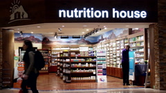 Nutrition house store prepare closing at night inside Coquitlam center mall Stock Footage
